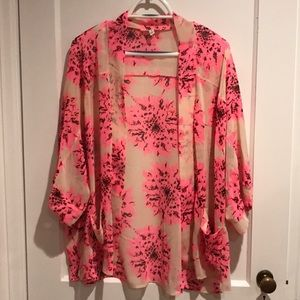 Nude and pink sheer floral top.